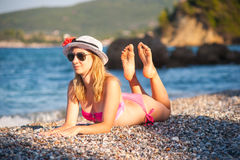 Young Girl Posing at Beach with Hat Royalty Free Stock Image