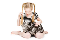 Young girl posing with british shorthair cat Royalty Free Stock Photography