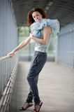 Young girl posing in a covered walkway Stock Photo