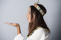 Young girl posing in egyptian clothing Stock Image