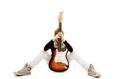 Young girl posing with guitar Royalty Free Stock Image