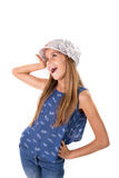 Young girl posing with a hat Royalty Free Stock Photos