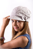 Young girl posing with a hat Stock Photos