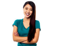 Young girl posing with her arms crossed Stock Photography