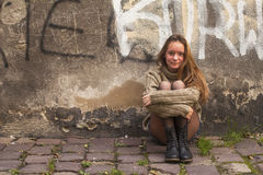 Young girl posing near a stone wall in the old town. Stock Image