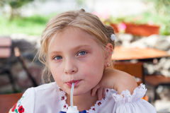 Young girl posing in an outdoor cafe Royalty Free Stock Photos