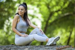 Young girl posing outdoor in her sportswear royalty free stock image