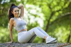 Young girl posing outdoor in her sportswear stock photos