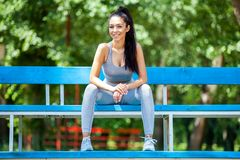 Young girl posing outdoor in her sportswear royalty free stock images