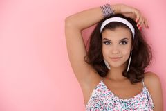 Young girl posing over pink wall Stock Photo