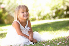 Young girl posing in park Stock Image