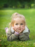 Young girl posing in park Royalty Free Stock Photo