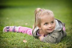 Young girl posing in park Royalty Free Stock Photography