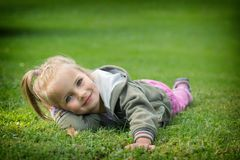 Young girl posing in park Stock Images