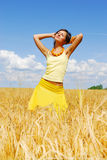 Young girl posing on plant of wheat. In sunny day Stock Images