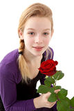 Young girl posing with red rose Royalty Free Stock Photos