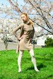 Young girl posing in the sakura garden Royalty Free Stock Photos