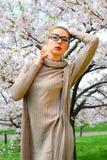 Young girl posing in the sakura garden Royalty Free Stock Photo