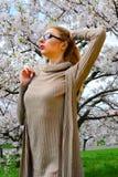 Young girl posing in the sakura garden Royalty Free Stock Image