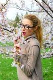 Young girl posing in the sakura garden Stock Image