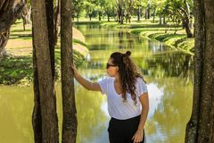 Young girl posing on the shore of a river stock photos