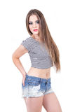 Young girl posing wearing denim shorts and crop Royalty Free Stock Image