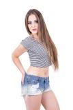 Young girl posing wearing denim shorts and crop Stock Image