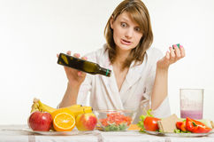 Young girl poured the oil into a vegetarian vegetable vitamin salad Stock Image