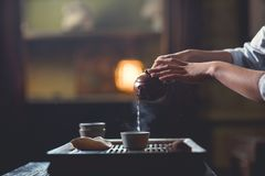 Female hands pouring tea from teapot Stock Photography
