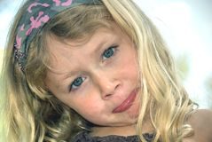 Young girl pouting. Portrait of young blond girl with a pout on her face stock images