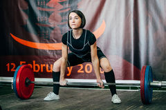 Young girl powerlifter exercise deadlift Royalty Free Stock Photo