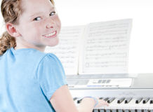 Young girl practicing piano Stock Images