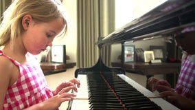 Young Girl Practicing Piano At Home Royalty Free Stock Photo