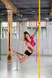 Young girl practicing pole dance Stock Image