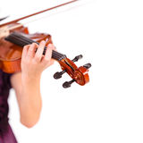 Young girl practicing the violin. Over white background Royalty Free Stock Photos
