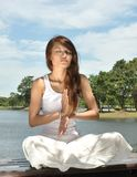 Young girl practicing yoga Stock Photos