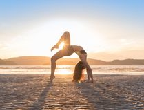 Young Girl Practicing Yoga On Beach At Sunset, Beautiful Woman Summer Vacation Meditation Seaside Royalty Free Stock Photo