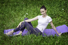 Young girl practicing yoga in a forest. Young girl practicing and meditating in a forest Stock Photography