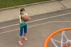 Young girl practising for the basketball team Royalty Free Stock Photos