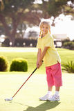 Young Girl Practising Golf. On Putting On Green Royalty Free Stock Images