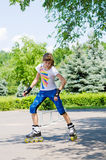 Young girl practising in a skate park Stock Photo