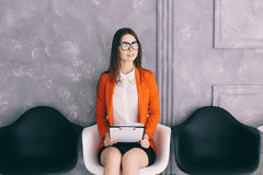 Young girl prapering for job interview  in waiting room Stock Photos