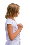 Young girl pray standing. Christian child pray to God - isolated kid on white background Stock Image