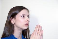 Young girl praying Stock Photo