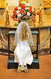 Young girl praying. Image of a young girl praying during her 1st communion Royalty Free Stock Images