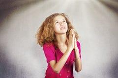 Young girl praying Stock Photos