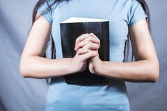 Free Young Girl Praying On The Bible Royalty Free Stock Photography - 215061547