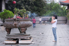 A young girl is praying in a pagoda in Saigon Royalty Free Stock Photos