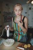 Young girl prepares dessert Stock Photo