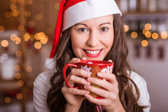 Young Girl preparing for Christmas. And holding hot tea / coffee Stock Image